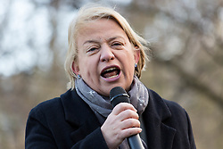 © Licensed to London News Pictures. 30/01/2016. London, UK. Green Pary leader, Natalie Bennett speaks to protesters from Lambeth Housing Activists, housing groups, trades unions and supporters at a  protest and march against the Housing Bill starting at the Imperial War Museum and ending outside Downing Street. Demonstrators claim that The Housing Bill marks the end of social housing and council housing and that private renters and travellers will have reduced housing rights and that developers will have to build 'starter homes' for sale instead of 'affordable' homes for rent. Photo credit : Vickie Flores/LNP