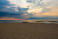 A wide angle photo of a beautiful sunrise over the Atlantic Ocean in Spring Lake, NJ on the 4th of July.