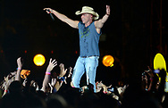 Country music star Kenny Chesney performs during the first stadium date on his new Goin' Coastal concert tour at Raymond James Stadium in Tampa, Fla., Saturday, March 19, 2011.(AP Photo/Phelan M. Ebenhack)