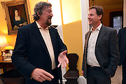 © Licensed to London News Pictures. 11/09/2013. London, UK Stephen Fry (L) talks to Nick Clegg. The Deputy Prime Minister, Nick Clegg, hosts a reception at Admiralty House in Whitehall this evening, 11 September 2013, to celebrate the government's progress in equal marriage. From next year gay people will be able to get married. A number of high profile guests including openly supportive celebrities, campaigners, religious figures and charities were in attendance.<br /> The London Gay Men Chorus Ensemble performed at the event. . Photo credit : Stephen Simpson/LNP