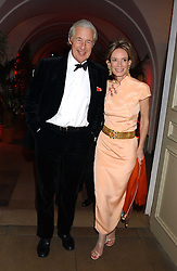 MARTIN & ANNE SUMMERS at a charity dinner 'By Imperial Command' - a Chinese New Year Gala Dinner in aid of the charity Kids held at The Banqueting House, Whitehall, London on 8th February 2006.<br />