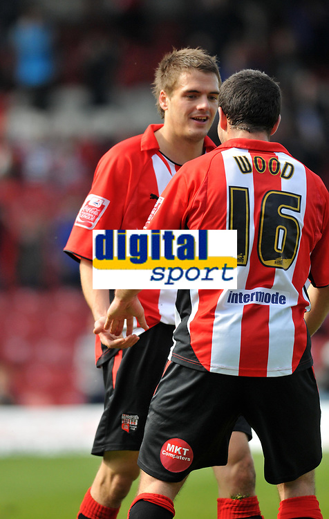 Photo: Tony Oudot/Richard Lane Photography. Brentford v Accrington Stanley . Coca-Cola Football League Two. 18/04/2009. <br /> Ryan Dickson celebrates his goal and Brentfords second with Sam Wood