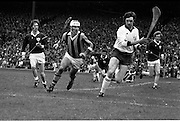 07/09/1975<br /> 09/07/1975<br /> 7 September 1975<br /> All-Ireland Hurling Final: Kilkenny v Galway at Croke Park, Dublin. <br /> Galway goalie, Michael Conneely (second from the right), has a determined look as he brings off one of his many good clearances with Kilkenny full-forward, Kieran Purcell (second from the left), in hot pursuit.