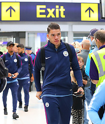 Ederson as the Manchester City team arrive at Manchester Airport as they jet for Iceland