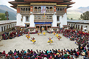 "Monks performing the Mask Dance ""PaChham"" at the Black-necked Crane festival at Gangte Goemba, Phobjikha Valley, Bhutan. Every year on November 11th, the local community hosts the Black-necked Crane festival at Gangte Goemba, to highlight its significance to the valley. Phobjikha Valley is the most significant overwintering ground of the rare and endangered Black-necked Crane in Bhutan."