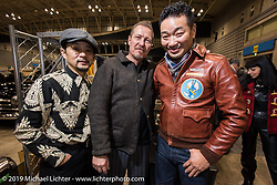Jeff Decker with a Chinese enthusiast and fan at the Annual Mooneyes Yokohama Hot Rod and Custom Show. Japan. Sunday, December 7, 2014. Photograph ©2014 Michael Lichter.