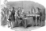Opening of the London to Paris telegraph link. Instrument room at the Submarine Telegraph Company, Cornhill, London, showing Wheatstone needle telegraph instrument. Wood engraving November 1852