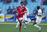 FOOTBALL - AFRICAN NATIONS CUP 2004 - FIRST ROUND - GROUP A - 040201 - TUNISIA v GUINEA - ZIAD JAZIRI (TUN) / OUSMANE CAMARA (GUI) - PHOTO JEAN MARIE HERVIO / FLASH PRESS<br />  *** Local Caption *** 40001021