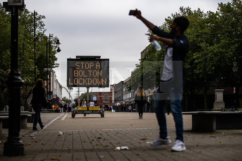 """© Licensed to London News Pictures . 16/09/2020. Bolton , UK . A sign advising visitors to Bolton Town Centre to """" Stop a Bolton Lockdown """" is placed in Victoria Square . The number of recorded cases of Coronavirus has gone over 200 in a single day , in Bolton . Photo credit : Joel Goodman/LNP"""