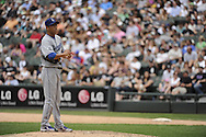 CHICAGO - MAY 22:  Hiroki Kuroda #18 of the Los Angeles Dodgers looks on during a pitching change against the Chicago White Sox on May 22, 2011 at U.S. Cellular Field in Chicago, Illinois.  The White Sox defeated the Dodgers 8-3.  (Photo by Ron Vesely)  Subject:   Hiroki Kuroda