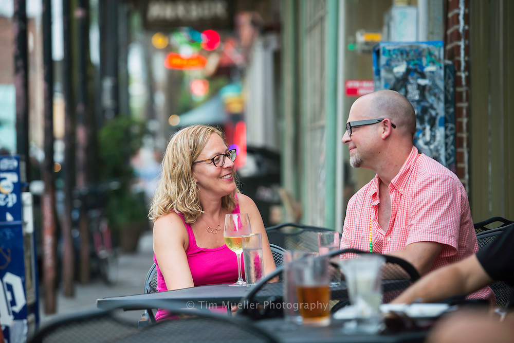 Wendy Rawlings and Joel Brouwer enjoy drinks outside a restaurant along Frenchmen Street. Frenchmen Street is in the Faubourg Marigny neighborhood near the French Quarter. The street is a thriving mix of music, food and fun, and is one of the most unique and vibrant entertainment locations in New Orleans.