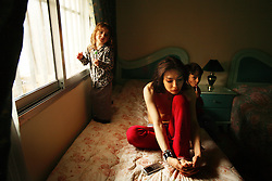 Samer Breitaa, relaxes at his home with his cousins Sarah and Amer Mousa, Beirut, Lebanon, April 9, 2006. Breitaa, who is half-Christian, half-Muslim, has had extensive plastic surgery done to achieve his unique look. The Lebanese continue to recreate their identity after years of war.