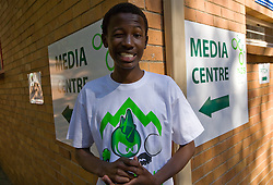 Young black volunteer at media centre during  training session of team Slovenia at  Hyde Park High School Stadium on June 9, 2010 in Johannesburg, South Africa.  (Photo by Vid Ponikvar / Sportida)