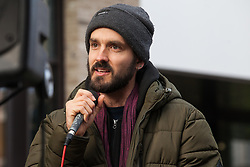 London, UK. 9th February, 2019. MC Dizraeli entertains activists from Extinction Rebellion blocking Kingsland Road in Dalston as part of a 'Saturday street party' intended as a means of engagement around climate change and environmental issues with the local community.
