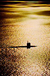 Submarine surfacing off of the coast of California at sunset