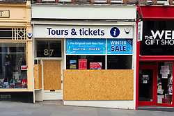 Edinburgh, Scotland, UK. 2 July, 2020. Because no tourists can travel to the UK, tourist shops on the normally busy Royal Mile in Edinburgh Old Town remain shut and boarded up. Streets are still mostly deserted since few locals live in the area. Pictured, Travel agent is closed and boarded up. Iain Masterton/Alamy Live News