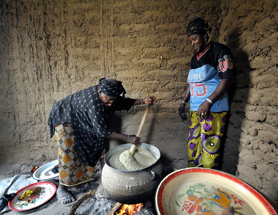 Fadimoutou Dicko (left), along with Ghaichatou Dicko, prepares food for children at a school in Timbuktu, a city in northern Mali which was seized by Islamist fighters in 2012 and then liberated by French and Malian soldiers in early 2013. During the jihadi occupation, schools were first closed but then allowed to reopen only if boys and girls were strictly separated. The ACT Alliance has provided this group of women with cereal grains, oil and salt to help them provide nutritious food for the children.