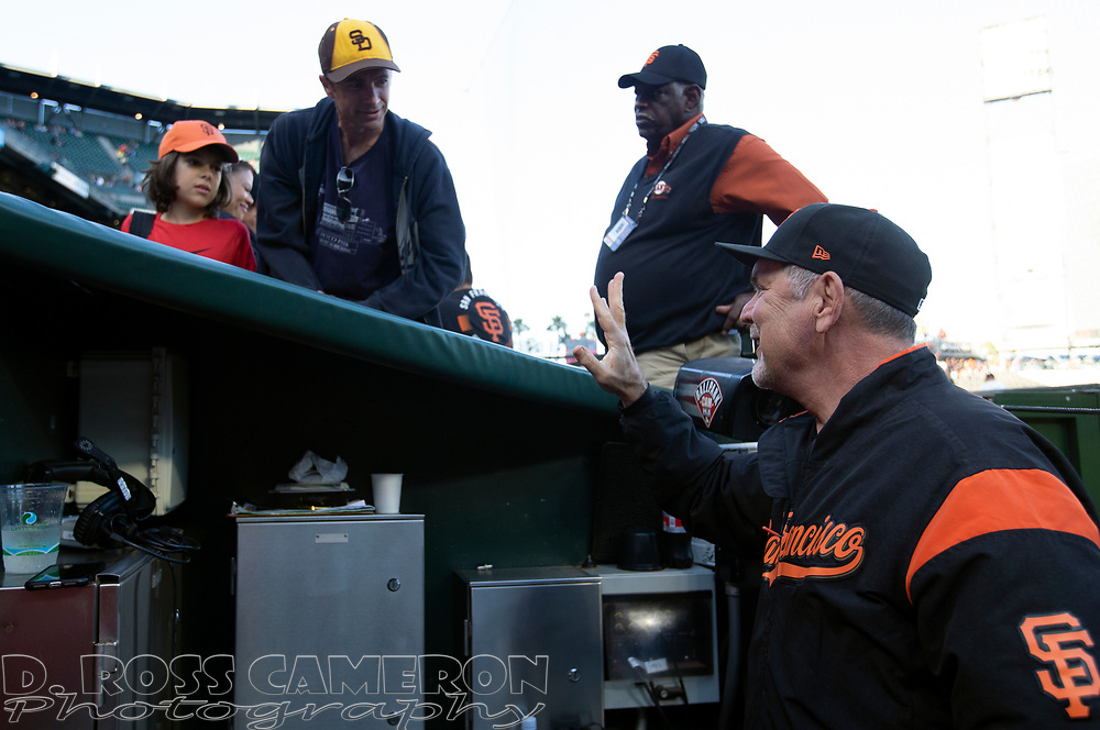 San Francisco Giants manager Bruce Bochy, right, chats with fans before a baseball game, Thursday, Aug. 29, 2019, in San Francisco. (AP Photo/D. Ross Cameron)