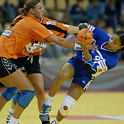 AARHUS 20021206 <br /> EURO 2002 HANDBALL WOMEN, Grupp B: France vs Holland. Diane Lamein of Holland trying to stop France Myriam Said Mohamed in the Grupp B match Friday Decamber 6, 2002, in Aarhus Denmark. <br /> PHOTO: CLAUS FISKER/SCANPIX CODE 93006