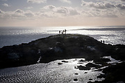 Walkers reach a hill top along a trail path in Holyhead Breakwater Country Park on the coast of Holyhead, Anglesey, North Wales, United Kingdom.20th February 2020. The country park opened in 1990 and is on the site of an old stone quarry.  (photo by Andrew Aitchison / In pictures via Getty Images)