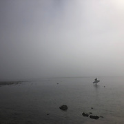 A lone surfer leaves the water at Malibu Surfrider Beach