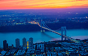 The George Washington Bridge – known informally as the GW Bridge, the GWB, the GW, or the George – is a double-decked suspension bridge spanning the Hudson River between the Washington Heights neighborhood in the borough of Manhattan in New York City and Fort Lee, New Jersey. As of 2015, the George Washington Bridge carries over 106 million vehicles per year, making it the world's busiest motor vehicle bridge. The bridge is owned by the Port Authority of New York and New Jersey, a bi-state government agency that operates several area bridges, tunnels and airports, and the PATH rapid transit system. Construction on the bridge began in October 1927 as a project of the Port of New York Authority.