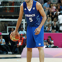 04 August 2012: France Nicolas Batum looks to pass the ball during 73-69 Team France victory over Team Tunisia, during the men's basketball preliminary, at the Basketball Arena, in London, Great Britain.