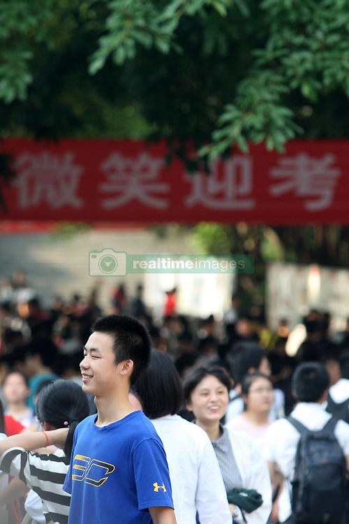 June 7, 2017 - Chongqing, Chongqing, China - Chongqing, CHINA-June 7 2017: (EDITORIAL USE ONLY. CHINA OUT) Examinees entering the examination site in southwest China's Chongqing, June 7th, 2017. It's the first day of the National College Entrance Examination on June 7th. About 9.4 million students attend the examination in China. (Credit Image: © SIPA Asia via ZUMA Wire)