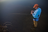 FLY ANGLER FISHING A RIVER IN FAR WEST TEXAS