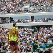PARIS, FRANCE June 09.  Rafael Nadal of Spain gets up off the clay court after falling to the ground to celebrate winning his twelfth French Open title after his victory against Dominic Thiem of Austria during the Men's Singles Final on Court Philippe-Chatrier at the 2019 French Open Tennis Tournament at Roland Garros on June 9th 2019 in Paris, France. (Photo by Tim Clayton/Corbis via Getty Images)