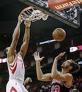 Nov 21, 2012; Houston, TX, USA; Houston Rockets power forward Greg Smith (4) dunks over Chicago Bulls center Joakim Noah (13) during the second quarter at the Toyota Center. Mandatory Credit: Thomas Campbell-US PRESSWIRE