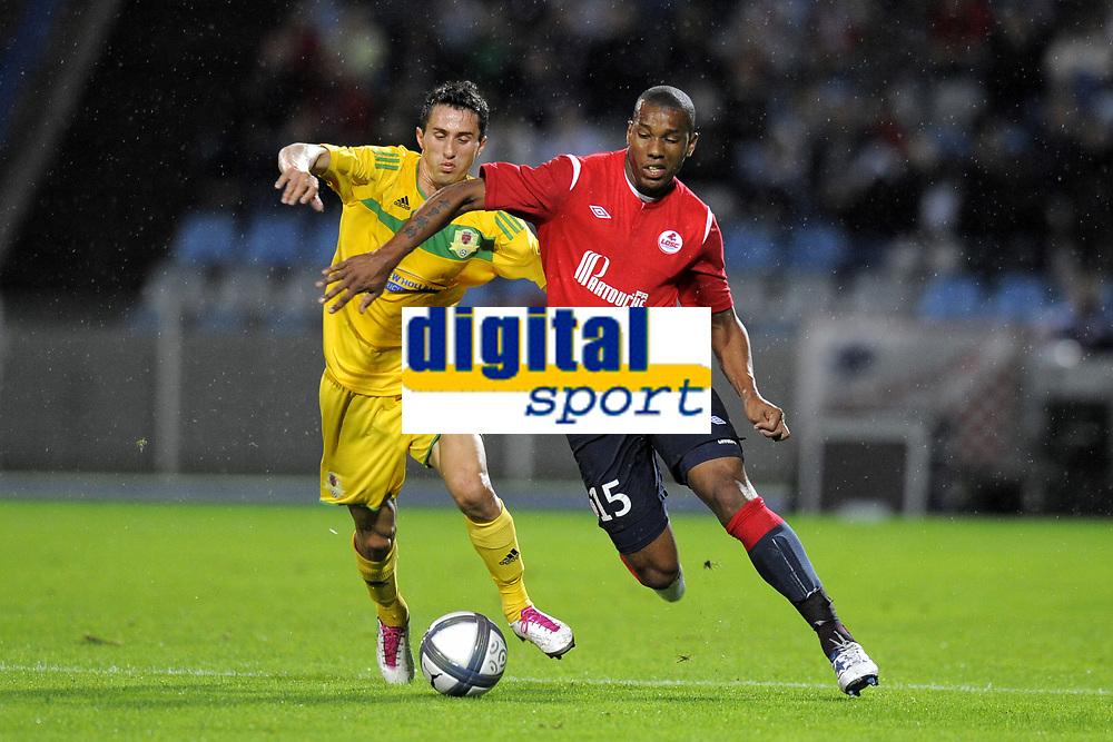 FOOTBALL - UEFA EUROPA LEAGUE 2010/2011 - PLAY OFF - 2ND LEG - LILLE OSC v FC VASLUI - 26/08/2010 - PHOTO JEAN MARIE HERVIO / DPPI - EMERSON (LOSC) / ADRIAN GHEORGHIU (FCV)