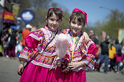 May 5, 2019 - St. Paul, MN, USA - United States - Identical twins Victoria, left, and Emily Rodriguez, 6, enjoyed some of the treats their mother Yuliana Rodriguez purchased at the Cinco de Mayo festivities, Saturday, May 4, 2019 in St. Paul, MN.  The girls wore dresses that are typical in the state of Jalisco, Mexico.  The parade and cultural event celebrates the annual celebration of Mexico over the French at the Battle of Puebla in 1862.      ]  ELIZABETH FLORES • liz.flores@startribune.com (Credit Image: © Elizabeth Flores/Minneapolis Star Tribune via ZUMA Wire)