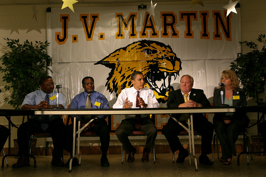 Sen. Barak Obama who was a presidential candidate at the time, listens to education professionals as they express their concerns about the school district during a press conference at J.V. Martin Junior High school