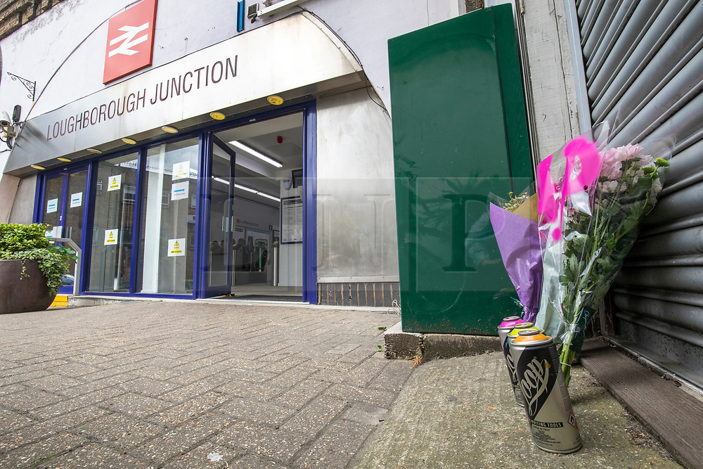 © Licensed to London News Pictures. 19/06/2018. London, UK. Flowers and cans of spray paint are left by Loughborough Junction station as a tribute for the three graffiti artists believed to have been killed by a night train. Photo credit: Rob Pinney/LNP