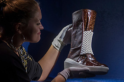 """© Licensed to London News Pictures. 11/09/2018. LONDON, UK. A staff member poses with """"Caskia/Growing a Mars Boot"""", designed by Liz Ciokajlo (OurOwnSkin) with Maurizio Montalti  at a preview of the 87 nominees for the eleventh Beazley Designs of the Year exhibition and awards at the Design Museum in Kensington.  The boot is made from mycellium fungus, fed on human sweat, and addresses the problem that Mars explorers will face in producing their own provisions and materials. The exhibition runs 12 September to 6 January 2019 and celebrates the most innovative designs of the last year.  Photo credit: Stephen Chung/LNP"""