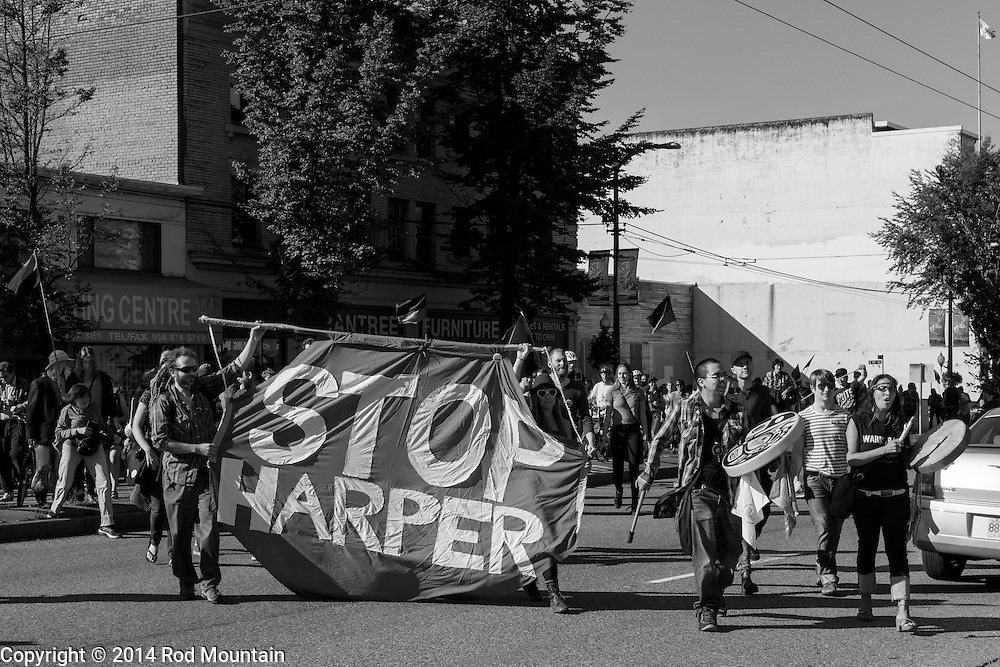 """Vancouver, BC, Canada - September 27, 2014 - A 'Stop Harper' banner is displayed as part of the """"Party Against the Pipelines"""" Protest in Vancouver, B.C. <br /> <br /> Photo: © Rod Mountain<br /> <br /> @rod_mountain<br /> <br /> http://www.rodmountain.com"""