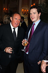 Left to right, ANDREW NEIL and GEORGE OSBORNE MP at The Business Winter Party hosted by Andrew Neil at The Ritz Hotel, Piccadilly, London on 7th December 2005.<br /><br />NON EXCLUSIVE - WORLD RIGHTS