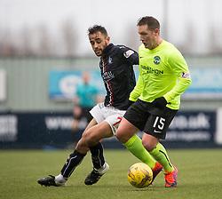 Falkirk's Tom Taiwo and Hibernian's Kris Commons. Falkirk 1 v 2 Hibernian, Scottish Championship game played 31/12/2016 at The Falkirk Stadium .