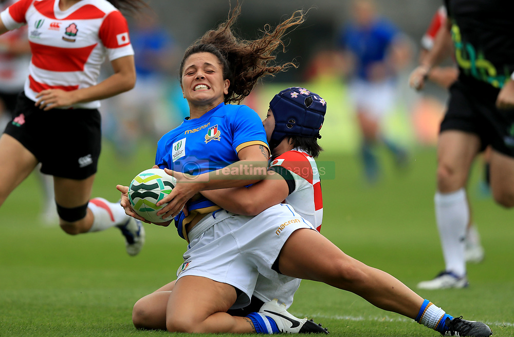 Italy's Maria Grazia Cioffi with Mayu Shimizu of Japan during the 2017 Women's World Cup, 9th Place Semi Final match at the Queen's University, Belfast.