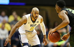 Jan 9, 2018; Morgantown, WV, USA; West Virginia Mountaineers guard Jevon Carter (2) defends Baylor Bears guard King McClure (22) during the second half at WVU Coliseum. Mandatory Credit: Ben Queen-USA TODAY Sports