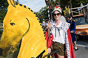 A woman dressed in costume rides a bicycle decorated as horses during the annual Independence Day golf cart and bicycle parade July 4, 2019 in Sullivan's Island, South Carolina. The tiny affluent Sea Island beach community across from Charleston holds an outsized golf cart parade featuring more than 75 decorated carts.
