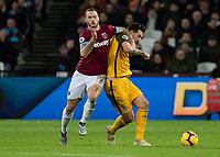 Football - 2018 / 2019 Premier League - West Ham United vs. Brighton & Hove Albion<br /> <br /> Marko Arnautovic (West Ham United) forces his way past Dale Stephens (Brighton & Hove Albion) at the London Stadium<br /> <br /> COLORSPORT/DANIEL BEARHAM