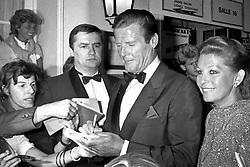 File - Roger Moore promotes his movie 'James Bond Dangereusement Votre' in 1985 in France. Photo by APS-Medias/ABACAPRESS.COM