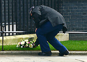 © Licensed to London News Pictures. 10/04/2013. Westminster, UK. Policemen with flowers for Margaret Thatcher on Downing Street today. David Cameron British Prime Minister leaves Downing Street today for a special session of recalled parliament to discuss the recent death of Margaret Thatcher . Photo credit : Stephen Simpson/LNP