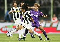 "Mauro German Camoranesi ( Juventus ) - Marco Donadel ( Fiorentina )<br /> Firenze 31/08/2008 Stadio ""Franchi"" <br /> Campionato Italiano Serie A 2008/2009<br /> Fiorentina Juventus (1-1)<br /> Foto Davide Elias Insidefoto"
