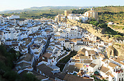 Whitewashed buildings on hillside in village of Setenil de las Bodegas, Cadiz province, Spain