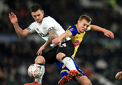 Derby County's Jack Marriott (left) and Southampton's James Ward-Prowse battle for the ball during the Emirates FA Cup, third round match at Pride Park, Derby.