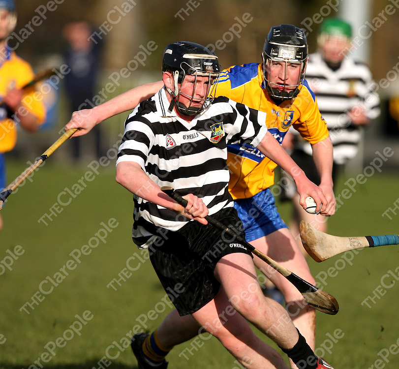 Clarecastle's Aaron Considine manges to hold possession despite the advances of Sixmilbridge's Robert McNamara during their minor league final clash in Sixmilebridge on Wednesday evening.<br /><br />Photograph by Yvonne Vaughan.