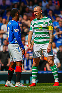 Celtic Captain Scott Brown talking to Jermain Defoe of Rangers FC during the Ladbrokes Scottish Premiership match between Rangers and Celtic at Ibrox, Glasgow, Scotland on 12 May 2019.